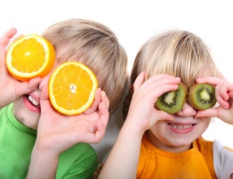 children playing with fruit